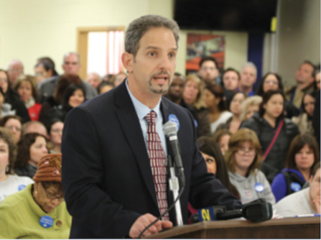 Mike Mignone speaks out against the purchase of a $2 million video and audio surveillance system at a Belleville school board meeting in April 2014. Photo: NJEA