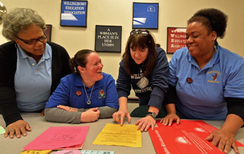Willingboro, N.J., educators and allies, including local union president Vicki Benedict, second from right, strategize before a school board meeting.