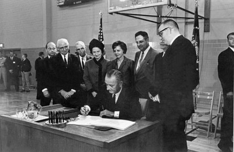 President Lyndon B. Johnson signs the Higher Education Act at San Marcos, Texas, on Nov. 8, 1965. (AP Photo)