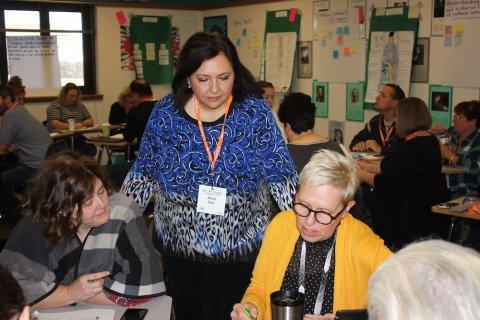 Alicia bata with teachers in classroom