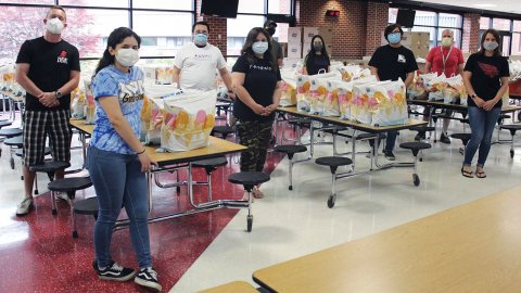 Chicago members of the Student Illinois Education Association partnered with area high school students to stock a food pantry for those affected by the pandemic.