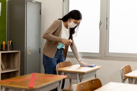 Teacher cleaning desk