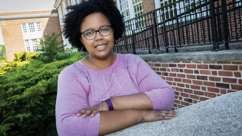 Counselor Shaniqua Williams stands outside her school